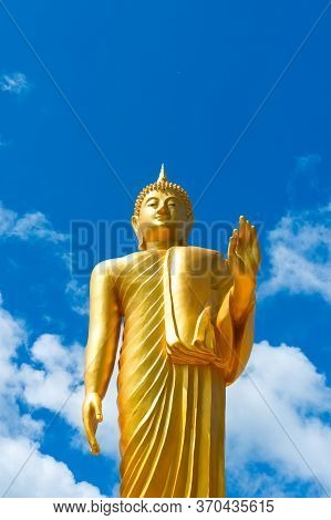 Beautiful Golden Buddha With Blue Sky In Thailand.for The Background Picture Advertising Detrimental