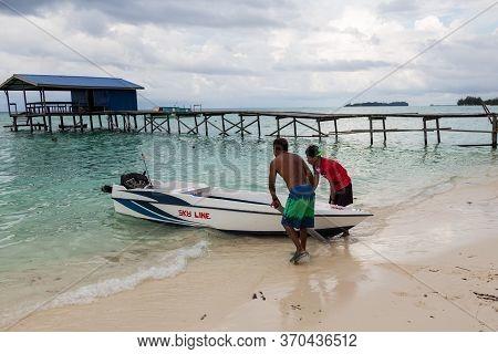 Mantanani Island, Sabah, Malaysia-circa September, 2017: Unidentified Local Fisherman Are Pushing A