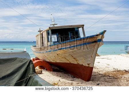 Abandon Boat At Sea Side And Ready To Repair By Local People At Mantanani Island, Sabah, Borneo
