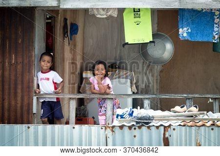 Mantanani Island, Sabah, Malaysia-circa September, 2017: Cute Kids Are Smell On Photographer While T