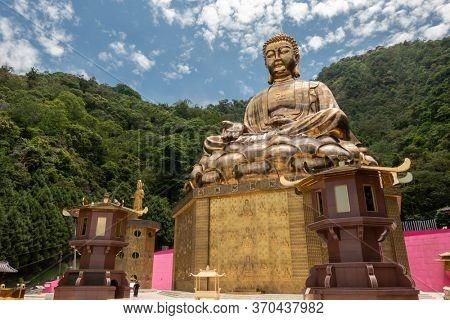 Puli, Taiwan - May 3th, 2020: big golden buddhist sculpture at Chengte Foshan, Puli township, Nantou, Taiwan