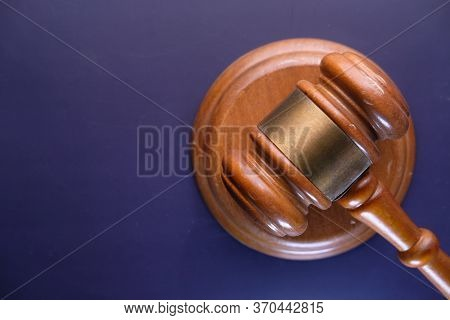 Top View Of Gavel On Dark Background With Copy Space