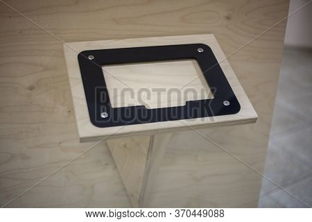 Wooden Stand For Inserting An Information Sheet. A Tablet For Viewing Text. The Exposition Of The Mu
