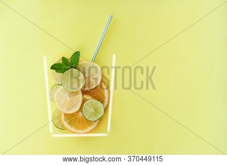 Summer Citrus Drink Concept. Orange, Lime And Lemon Slices On Yellow Background With A Straw. Stroke