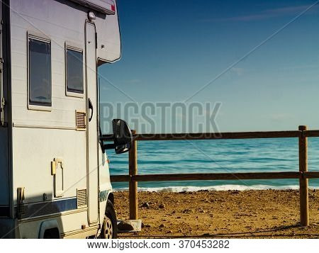 Camper Rv Caravan On Mediterranean Coast In Spain. Wild Camping On Nature Beach. Holidays And Travel