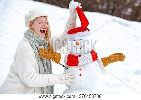 Snowman And Snow Day. Cute Snowman At A Snowy Village. Greeting Snowman. Snowman In Snow Forest