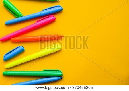 Felt-tip Pens On A Yellow Background With Copy Space, Set Of New Bright Plastic Opened Colored Felt