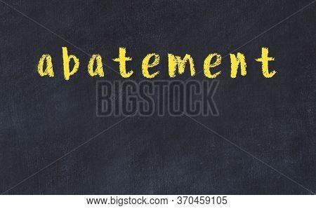 Chalk Handwritten Inscription Abatement On Black Desk