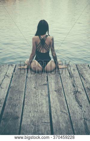 Beautiful Young Woman In Beachwear Near Water. Female Sexy Body. Perfect Body. Beautiful Young Woman
