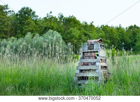 A Homemade Bee Hotel In A Field.