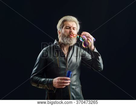 Handsome Man Blowing Bubbles. Soap Bubbles. Play With Bubbles. Bearded Man Blowing Soap Bubbles. Hap