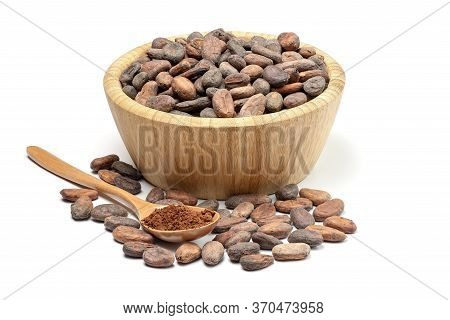 Raw Cocoa Beans In Wooden Bowl And Spoon With Cocoa Powder. Chocolate Ingredients Isolated On White