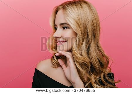 Close-up Portrait Of Gorgeous Young Woman With Shiny Hair Isolated On Pink Background. Indoor Photo