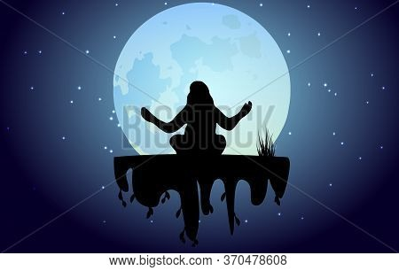 Silhouette Of A Young Woman Practicing Yoga Against The Background Of The Night Sky And The Big Moon