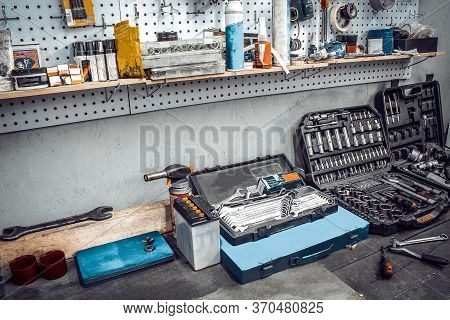 Inside The Workshop. Large Workbench And Tools Kit For Working On The Table Close-up. Workspace For