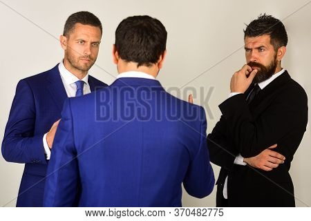 Executives Trying To Compromise On Light Grey Background.