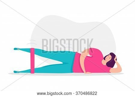 Woman Exercising With A Resistance Band. Woman Laying On Her Side And Doing Leg Press. Glutes Workou