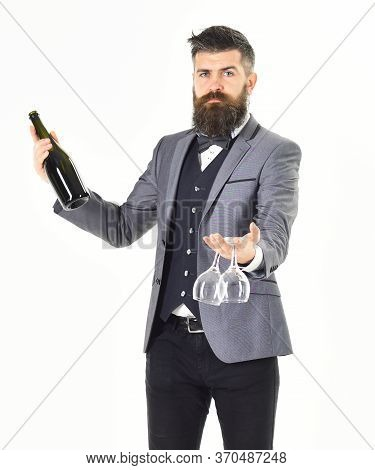 Sommelier With Wine Concept. Sommelier Wears Formal Suit And Bow Tie