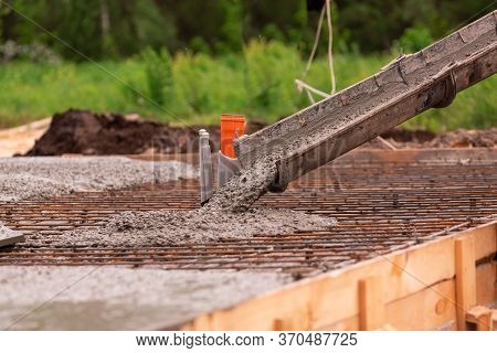 Lay Of The Cement Or Concrete Into The Foundation Formwork From Concrete Mixer