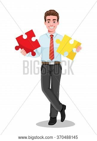 Successful Business Man Holding Two Pieces Of Puzzle. Handsome Businessman In Business Clothes. Chee