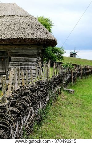Wooden Rural Fence In Village Near The House Near The Forest. Authentic Traditional Culture In Archi