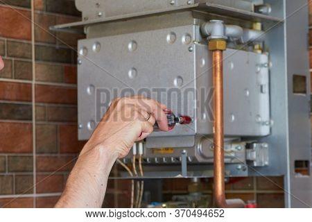 Disassemble The Gas Boiler, Hand Unscrews The Bolt On The Gas Boiler, Boiler Repair