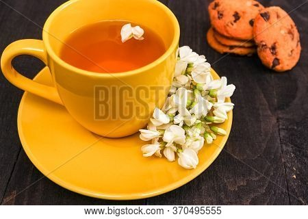 Cup Of Herbal Tea And Acacia Closeup. Herbal Tea From Acacia As A Concept Of Healthy Nutrition. Back