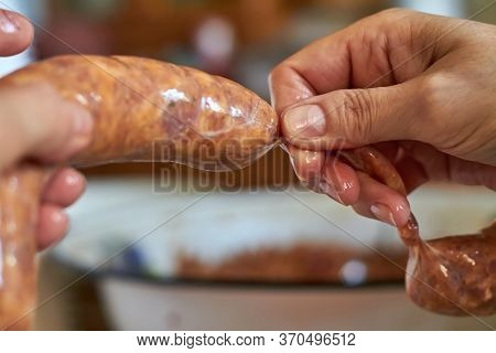 A Woman Manually Makes Homemade Sausage Using Natural Gut. Traditional Cuisine. Selective Focus