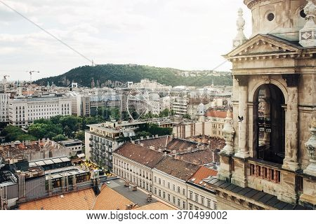 View From Basilica Of Saint Stephen On Cityscape With Ferris Wheel Of Budapest, Hungary
