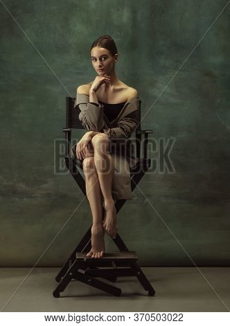 Beautiful Portrait. Graceful Classic Ballerina Dancing, Posing Isolated On Dark Studio Background. S