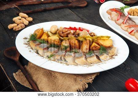 Russian Vodka Appetizer Set Herring Pickles Potatoes And Marinated Honey Mushrooms, Horizontal