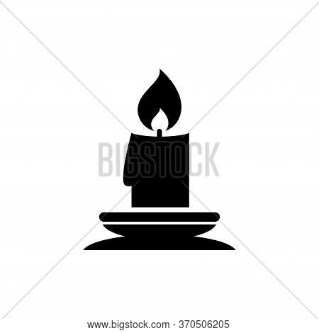 Christmas Lit Candle And Candlestick Holder. Flat Vector Icon Illustration. Simple Black Symbol On W