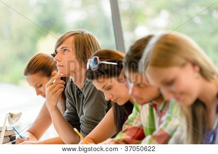 High-school student thinking at exam class teens writing college study poster