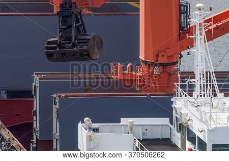 Bulk Carrier - Unloading The Ship At The Seaport Wharf