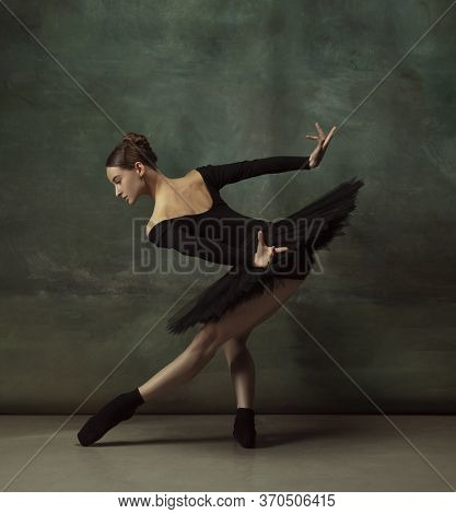Mystic Mood. Graceful Classic Ballerina Dancing, Posing Isolated On Dark Studio Background. Elegance