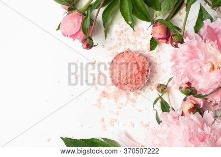 Natural Organic Cosmetic Products With Pink Peonies Flowers On White Background. Spa Relax Treatment