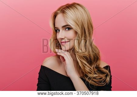 Romantic European Girl With Blue Eyes Posing With Interested Face Expression In Studio. Winsome Curl