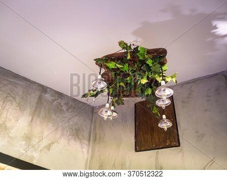 Vintage Style Hanged Ceiling Lamp Warm Orange Tone Light Color Concrete Background Wall
