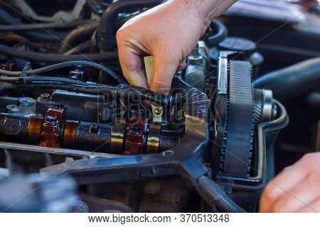 Car Mechanic Fixing Car Engine, Auto Mechanic Is Repairing Car Engine