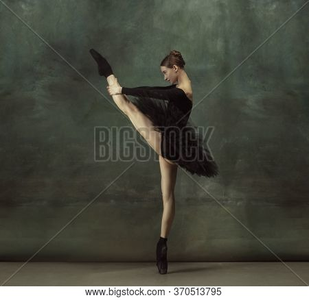 Dancing Night. Graceful Classic Ballerina Dancing, Posing Isolated On Dark Studio Background. Elegan