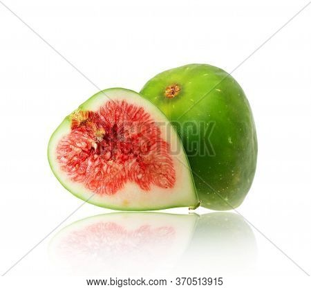 Whole And Sliced Ripe Green Fig Closeup On A White Background