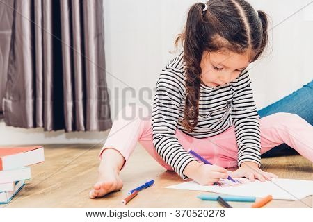Happy Child Kid Girl Kindergarten Drawing On Peper Teacher Education At Interior Room Home