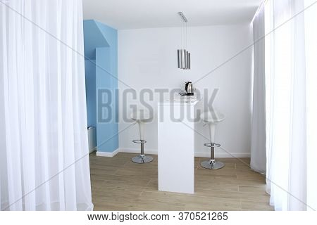 A Small Entrance Hall In Blue And White Tones In A Hotel Room. White Curtains In The Interior. Photo