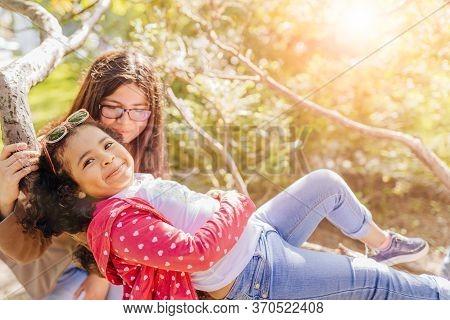 Cute Little Preschooler Hispanic Girl Take Off Mask On Chin Playing In City Park, Her Smiling Lovely