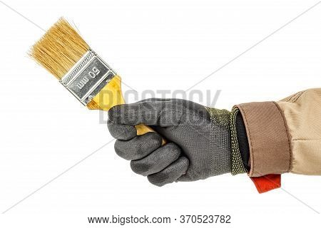 Unused Construction Paintbrush In Worker Hand In Black Protective Glove And Brown Uniform Isolated O