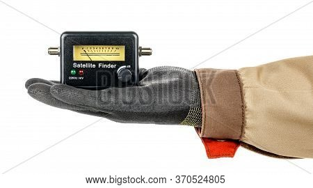 Satellite Finder Lies In Palm Of Man Hand In Black Protective Glove And Brown Uniform Isolated On Wh