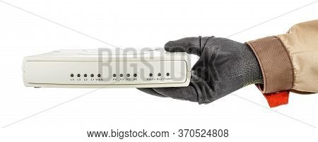Man Hand In Black Protective Glove And Brown Uniform Holding Voip Gateway Isolated On White Backgrou