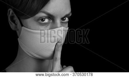 Portrait Young Woman In Protective Mask Showing Gesture Silence On Black Background, Empty Place, Gi