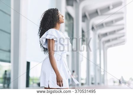 Arriving To Homeland. Side View Portrait Of Pleased Black Woman Standing Outside Of Airport After Ar