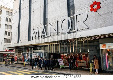 Geneva Switzerland , 3 January 2020 : Manor Ag Department Store Entrance With Logo And People In Gen